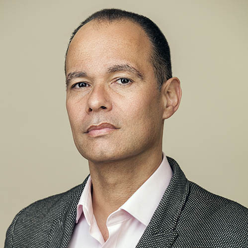 A corporate headshot of middle aged man from London