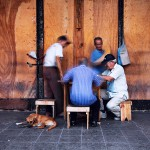 Elderly Cuban Men finishing game of domino.