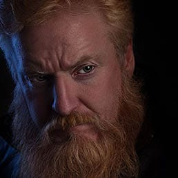 actor headshots london low key headshot portrait of a man with long ginger beard