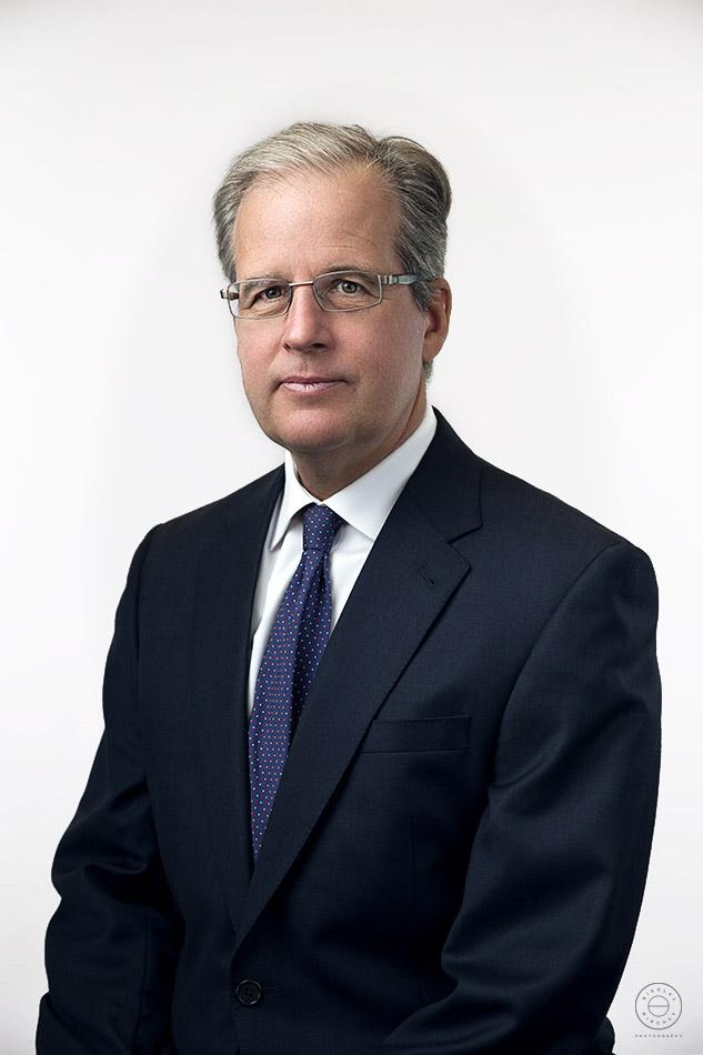 CEO of company corporate headshot in company's office