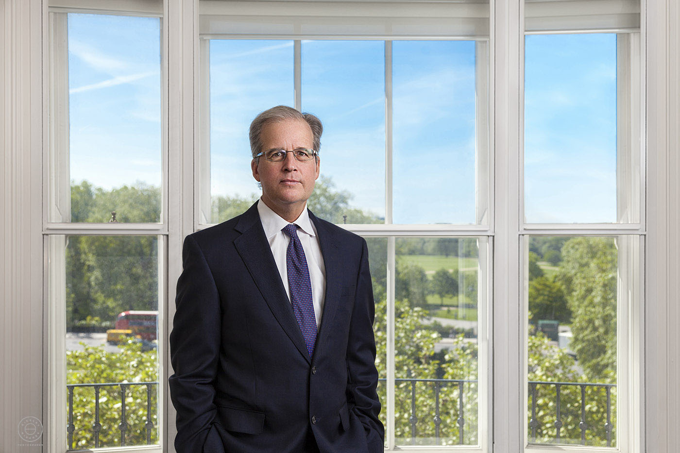 Corporate portrait by the wnidow with view of Hyde Park London