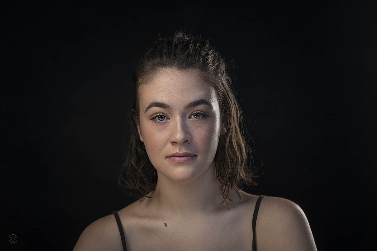 A low-key Actress headshot photographed in a studio