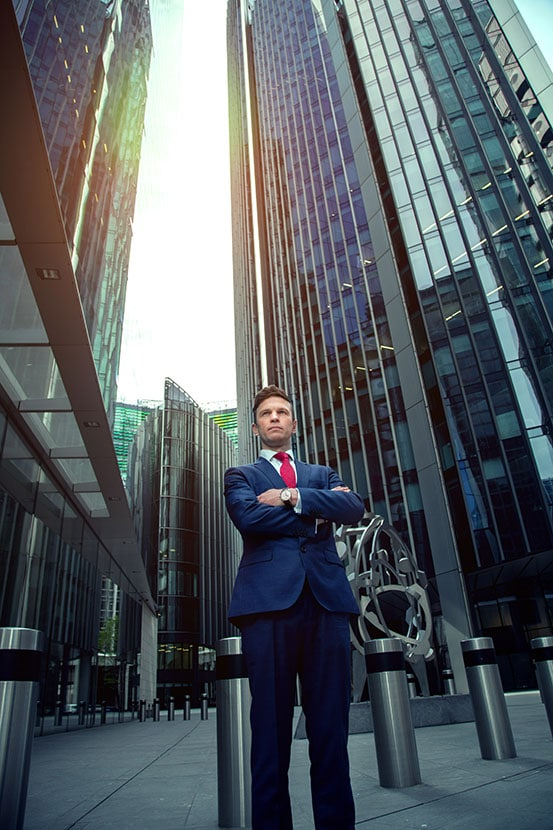 London portrait photographer NIkolay Mirchev captured this business portrait of a corporate professional in an urban environment surrounded by skyscrapers in the city of London.