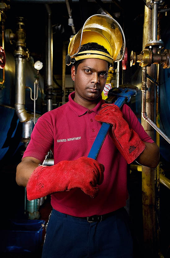 A maintenance man photographed in a boiler house he is servicing